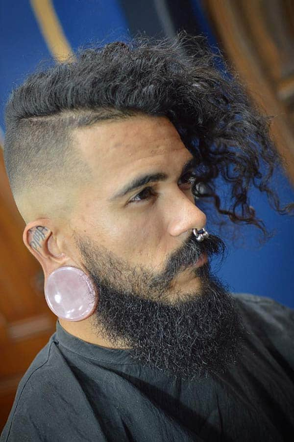 Long Curls And Undercut #combover #undecut #curlyhair #fadehaircuts #menshaircuts #beardstyle