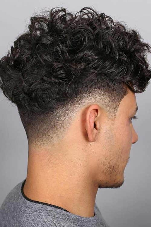 Low Fade With A Curly Faux Hawk #lowfade #fauxhawk #curlytop