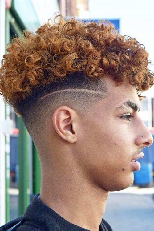 Curly Mohawk Fade With Shaved Stripe #mohawkfade #menhaircuts